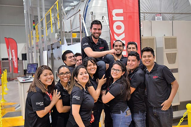 Administration and Operation Employees holding Carlos Navarro