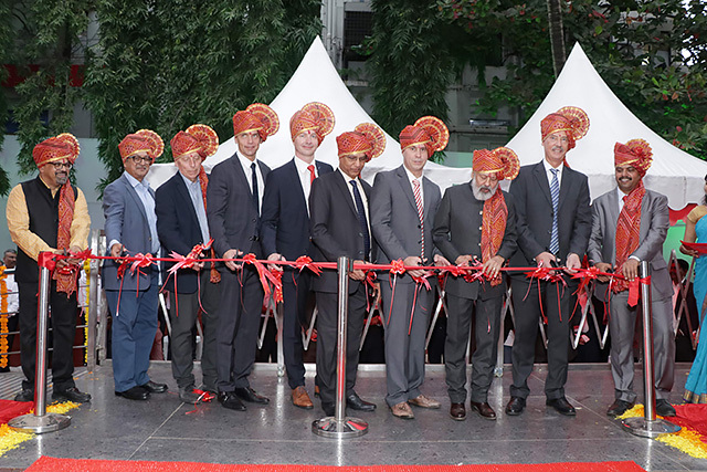 Production officially begins as the invited guests of honour and Oerlikon Balzers management cut the ribbon