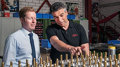 Christian Wagner, CEO MHT, (l.) and Michael Bilo from Oerlikon Balzers with BALINIT-coated mold cores