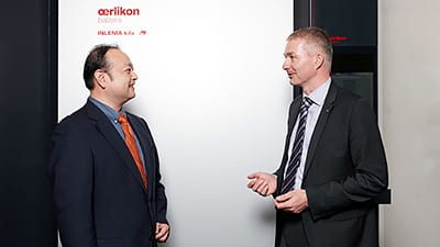 Kazuyuki Kubota and Wolfgang Kalss, Head of Marketing & Product Management Tools from Oerlikon Balzers in front of an INLENIA kila.